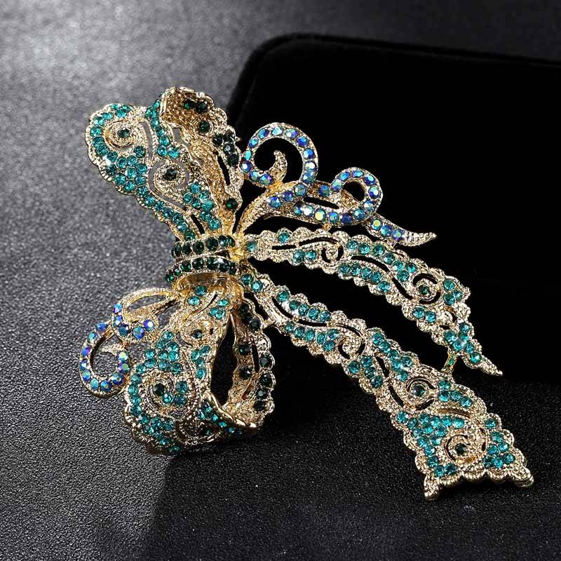 Kawaii Bow Shaped Rhinestone Women's Brooches Brooches cb5feb1b7314637725a2e7: Gold Blue|Gold Brown|Gold Violetta|White